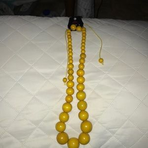 Yellow beaded necklace with matching earrings